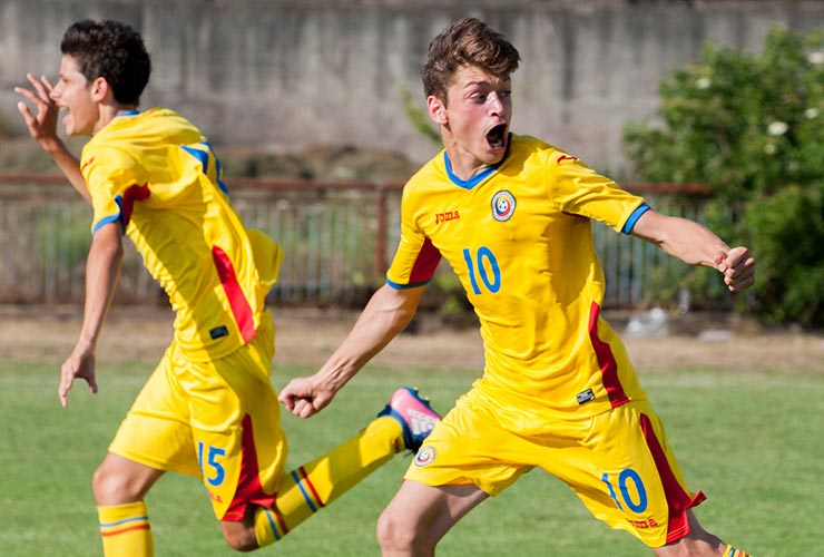 beautiful picture of romania young football player celebrating a goal