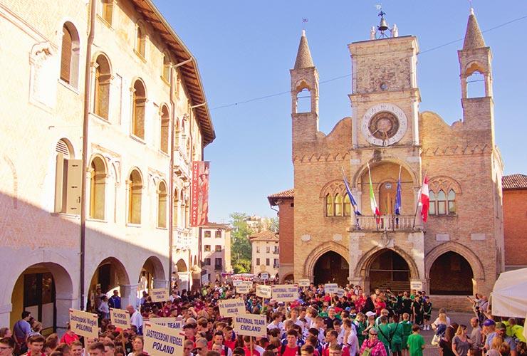 pordenone city hall with parade of football teams