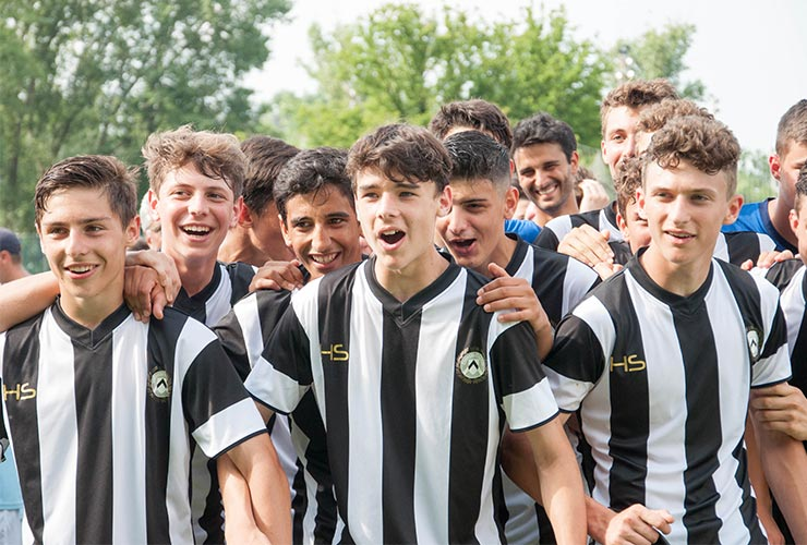 happy football players of udinese youth team