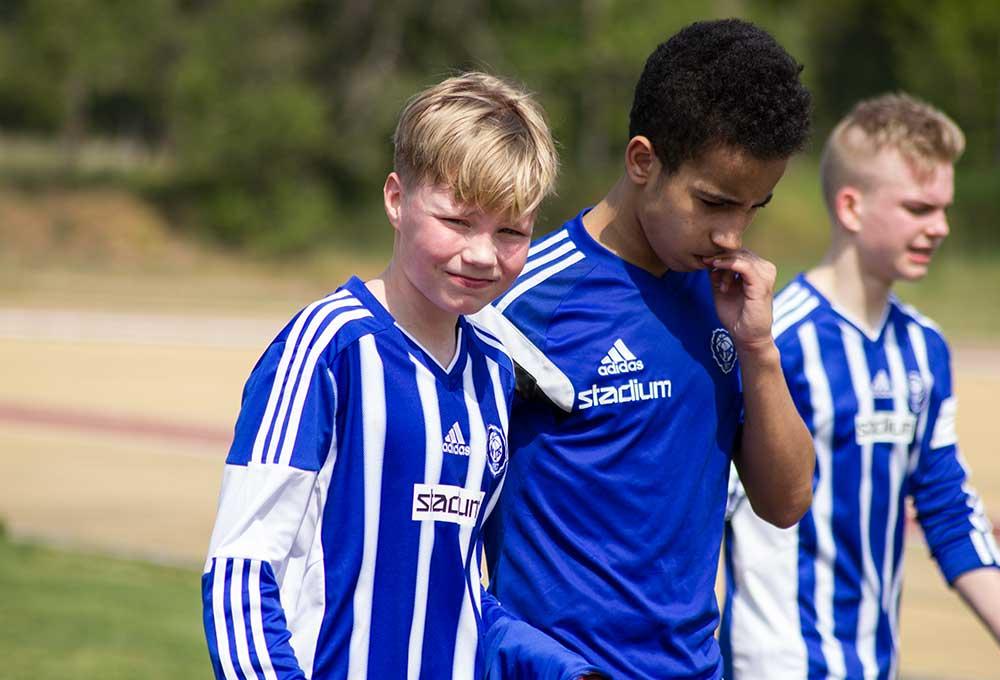 swedish blonde football player looking on camera